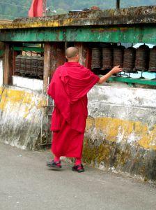 Buddhist monks turning prayer wheels - photo by Subhadip Mukherjee